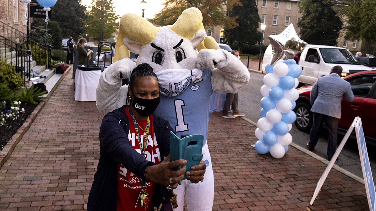 A woman takes a selfie with Rameses.