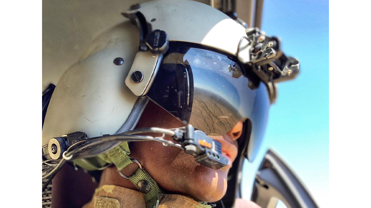 Lindsey Jefferies in the cockpit of a Black Hawk helicopter.